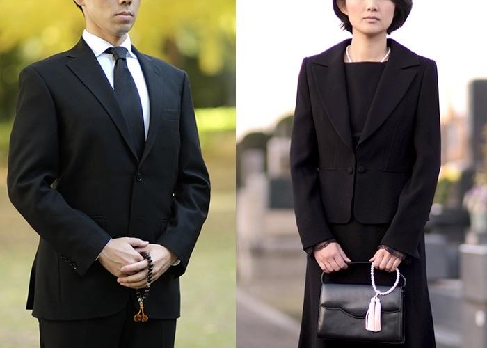 お葬式のスーツ姿の男女