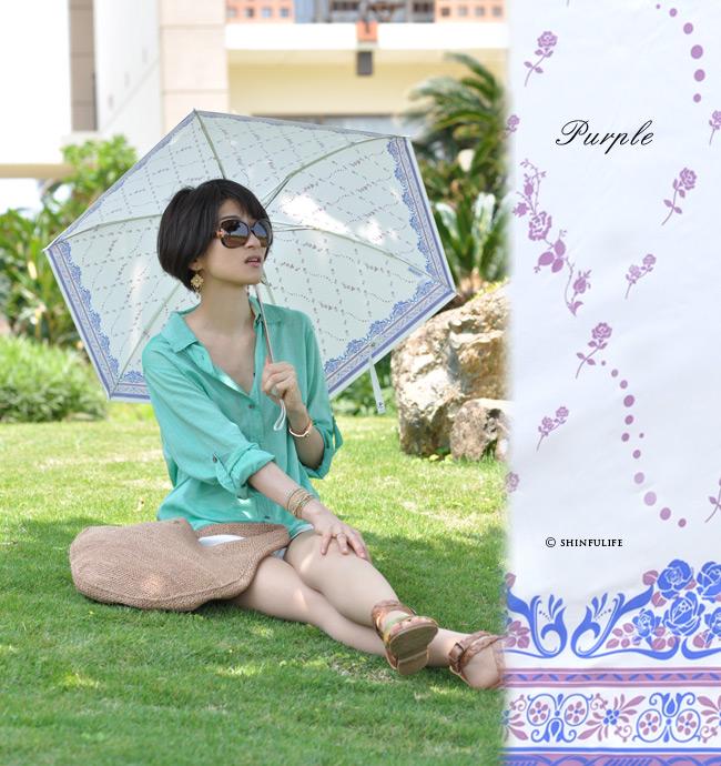 美しいローズプリントの軽量折り畳み日傘。白でもuvカット99.8%以上!UVION プレミアムホワイト おりたたみ日傘/晴雨兼用/遮熱効果でひんやりクールダウン/紫外線/完全遮光や1級遮光と違い瞳に安全な日傘/花柄/日本製/丈夫/折りたたみ/母の日/プレゼントモデル写真 パープル