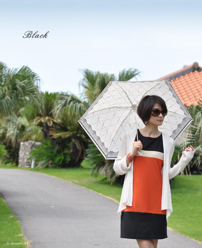 美しいローズプリントの軽量折り畳み日傘。白でもuvカット99.8%以上!UVION プレミアムホワイト おりたたみ日傘/晴雨兼用/遮熱効果でひんやりクールダウン/紫外線/完全遮光や1級遮光と違い瞳に安全な日傘/花柄/日本製/丈夫/折りたたみ/母の日/プレゼントモデル写真 ブラック